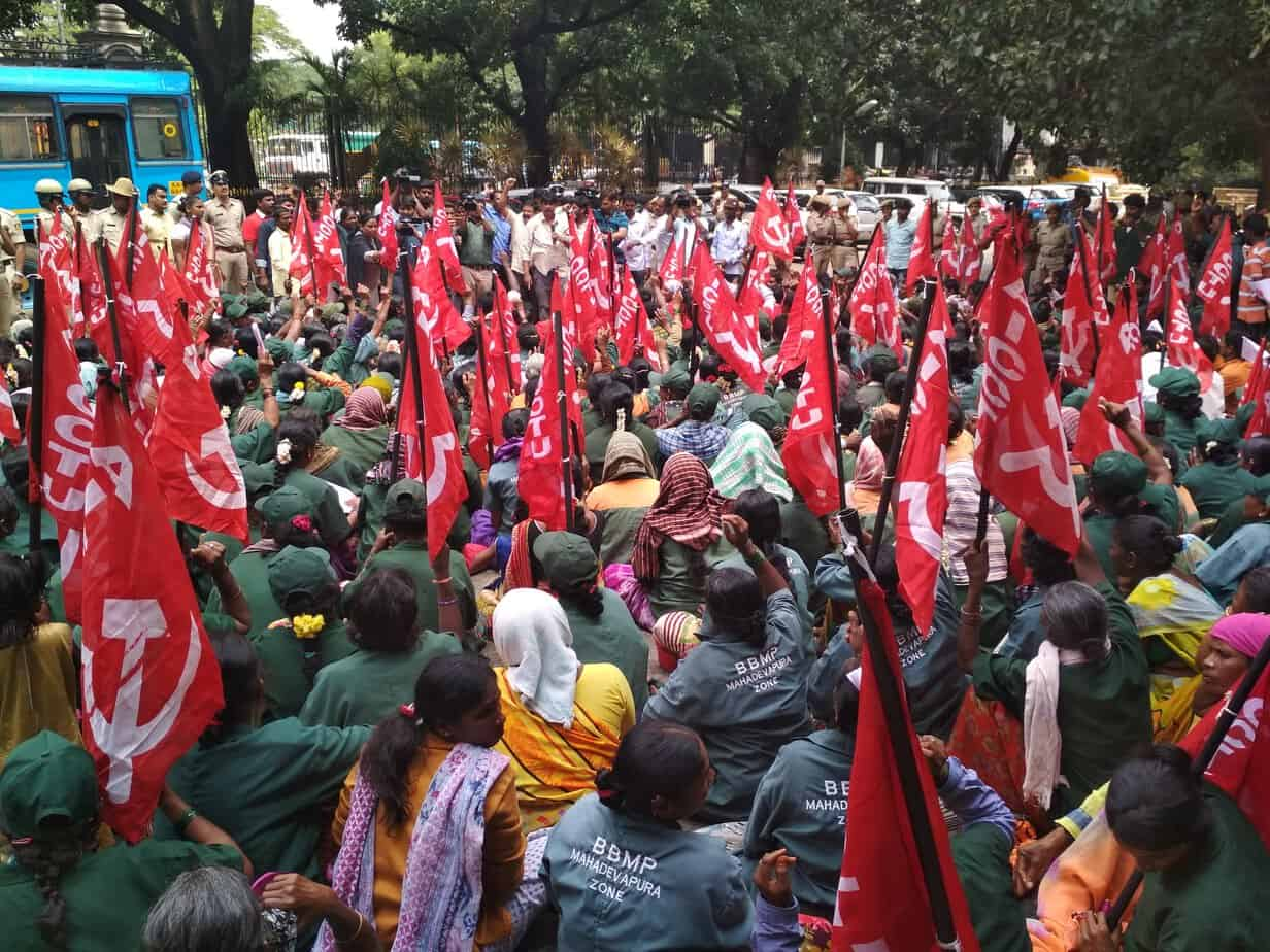 Thousands of workers from all eight BBMP zones gathered to protest outside the BBMP office. Pic: BBMP Powrkarmikara Sangha