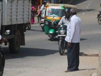 A pedestrian waiting to cross the road. Pic: The Footpath Initiative