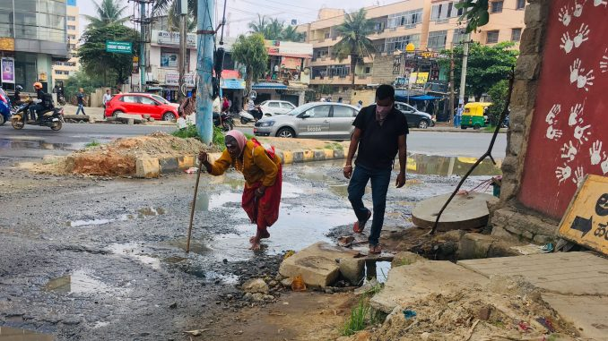 Potholes across the city has caused inconvenience not just to commuters but also pedestrians. Pic: Meera K