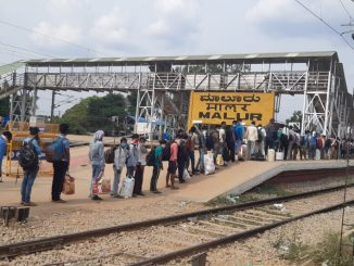 Migrant Workers of Bangalore queuing up to travel home from Malur Station on Shramik Trains